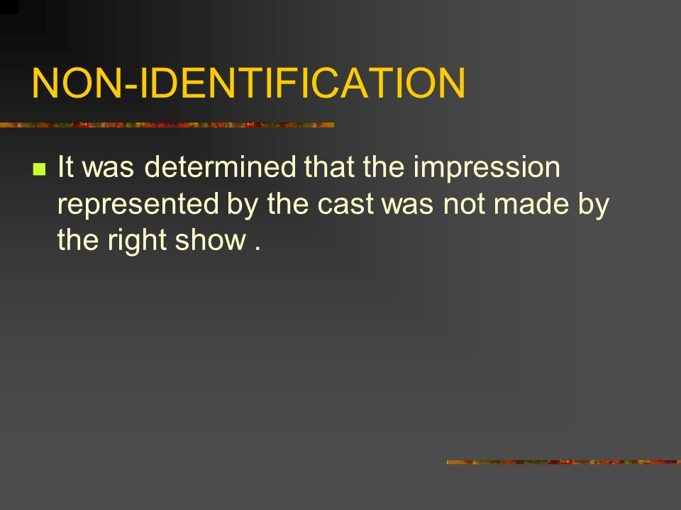NON-IDENTIFICATION It was determined that the impression represented by the cast was not made by the right show .