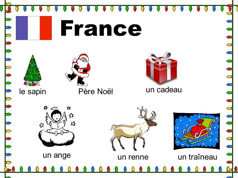 France un cadeau le sapin Père Noël un ange un renne un traîneau