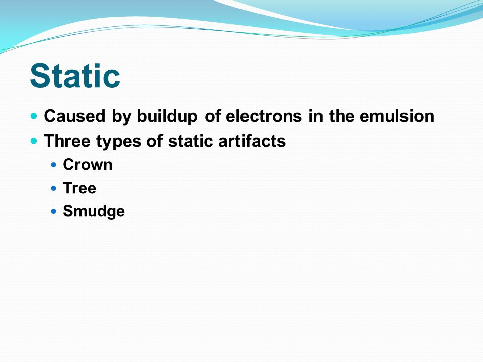 Static Caused by buildup of electrons in the emulsion
