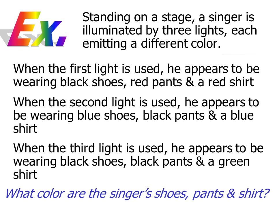 Standing on a stage, a singer is illuminated by three lights, each emitting a different color.
