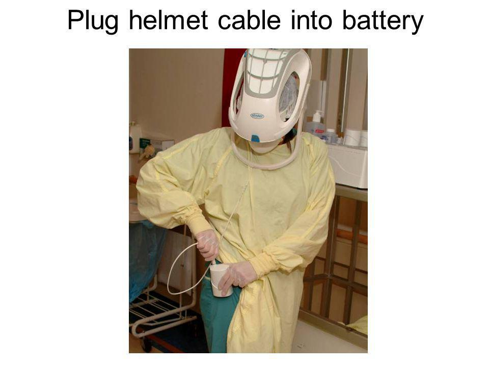 Plug helmet cable into battery