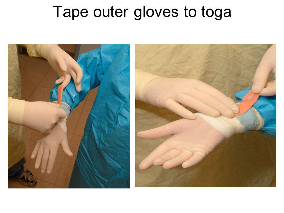Tape outer gloves to toga