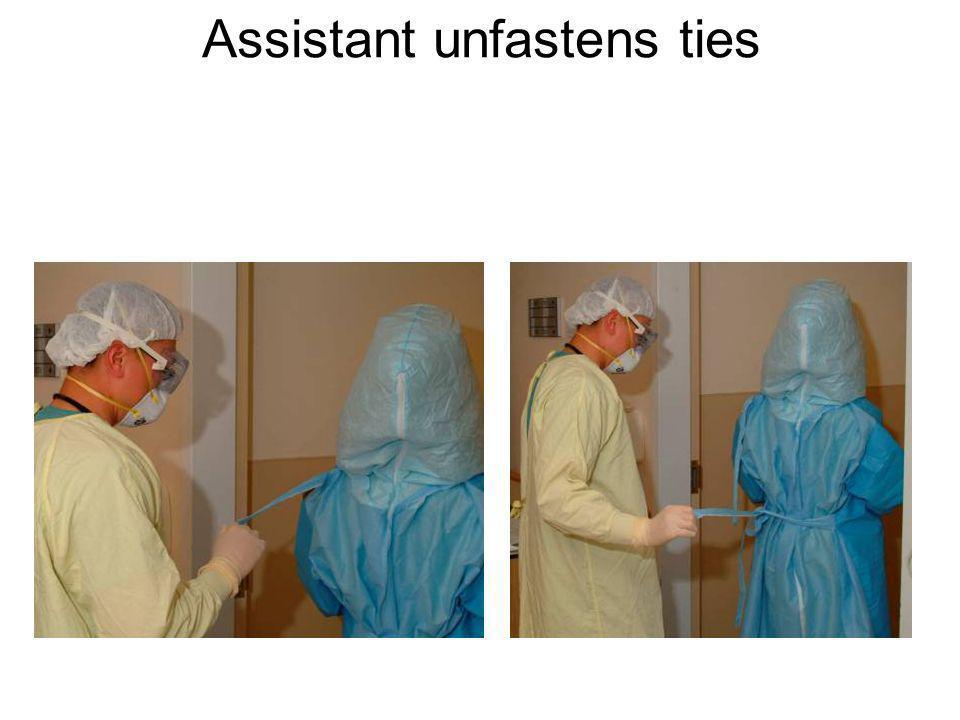 Assistant unfastens ties