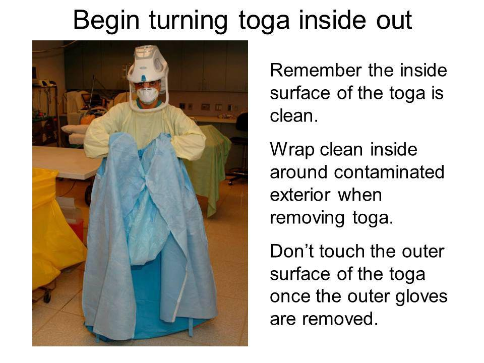 Begin turning toga inside out