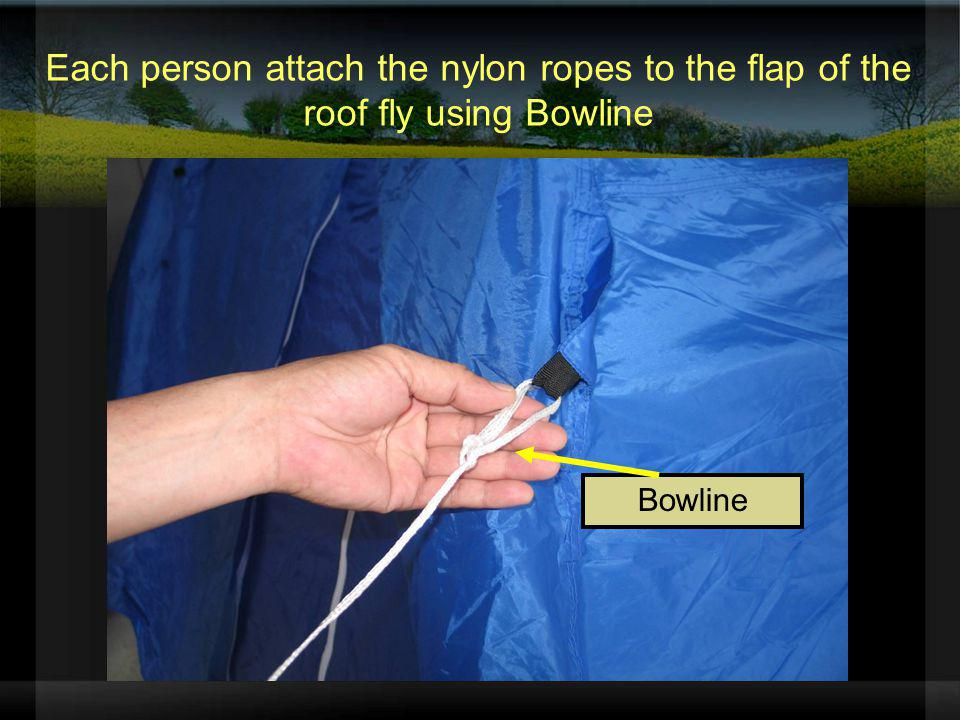 Each person attach the nylon ropes to the flap of the roof fly using Bowline