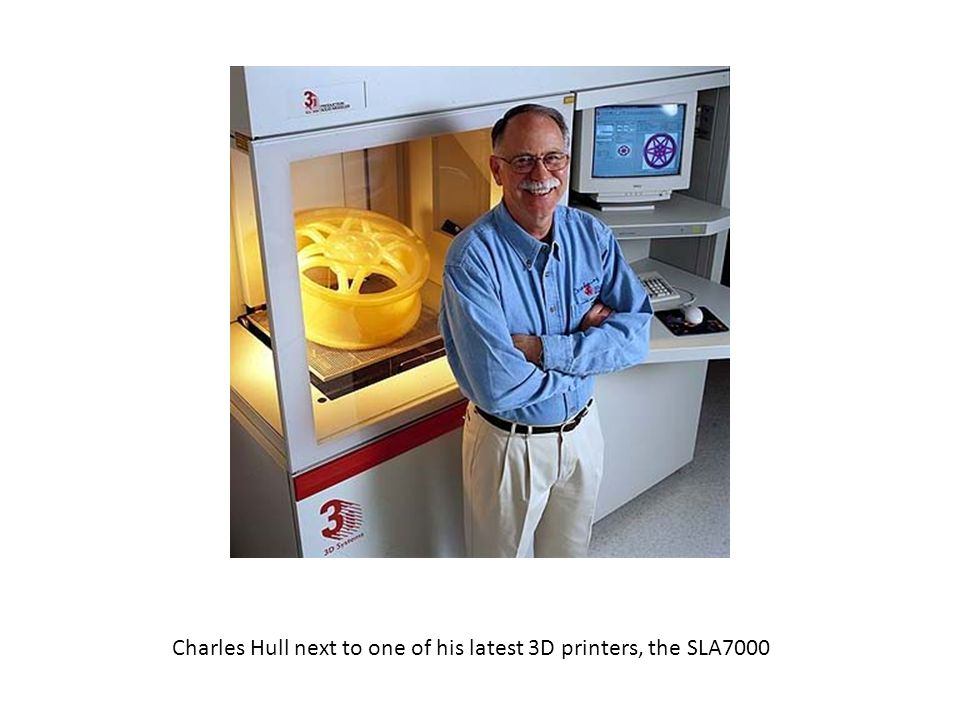 Charles Hull next to one of his latest 3D printers, the SLA7000