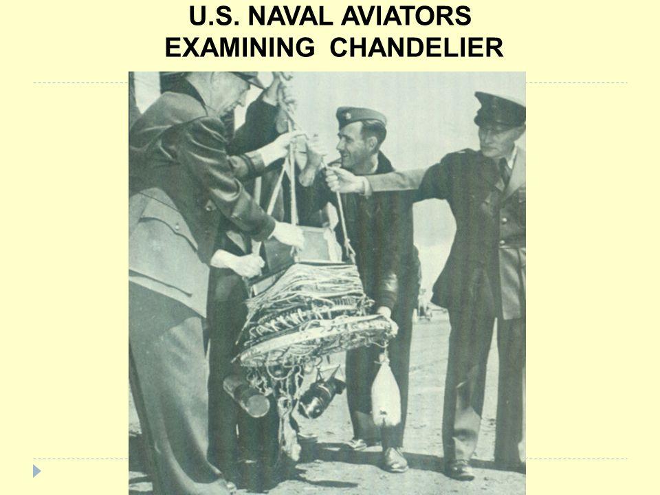 U.S. NAVAL AVIATORS EXAMINING CHANDELIER