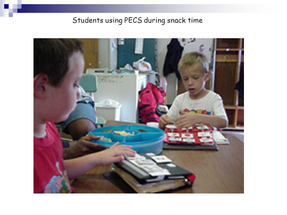 Students using PECS during snack time