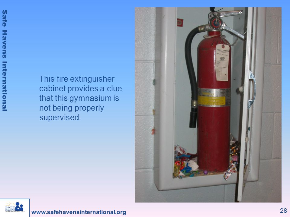 This fire extinguisher cabinet provides a clue that this gymnasium is not being properly supervised.