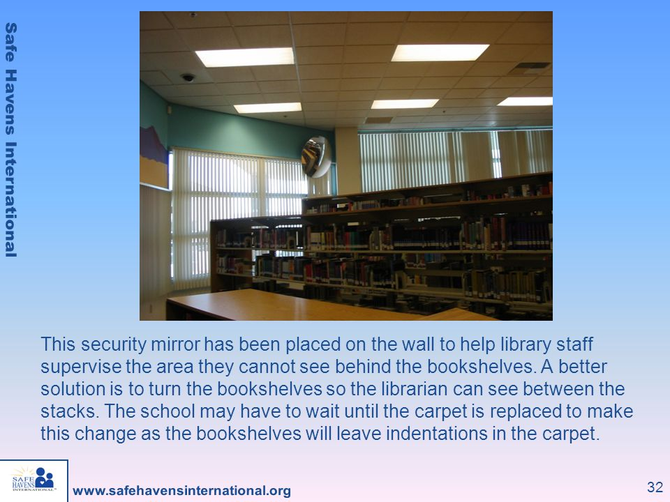 This security mirror has been placed on the wall to help library staff supervise the area they cannot see behind the bookshelves.