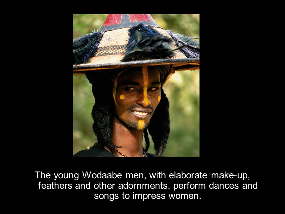 The young Wodaabe men, with elaborate make-up, feathers and other adornments, perform dances and songs to impress women.