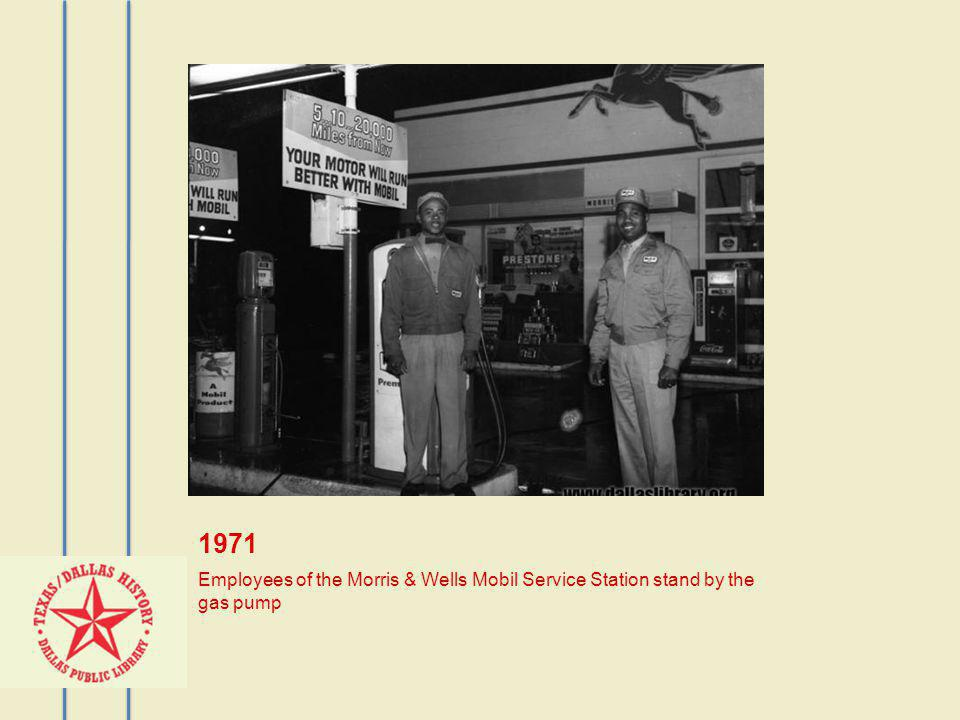 1971 Employees of the Morris & Wells Mobil Service Station stand by the gas pump