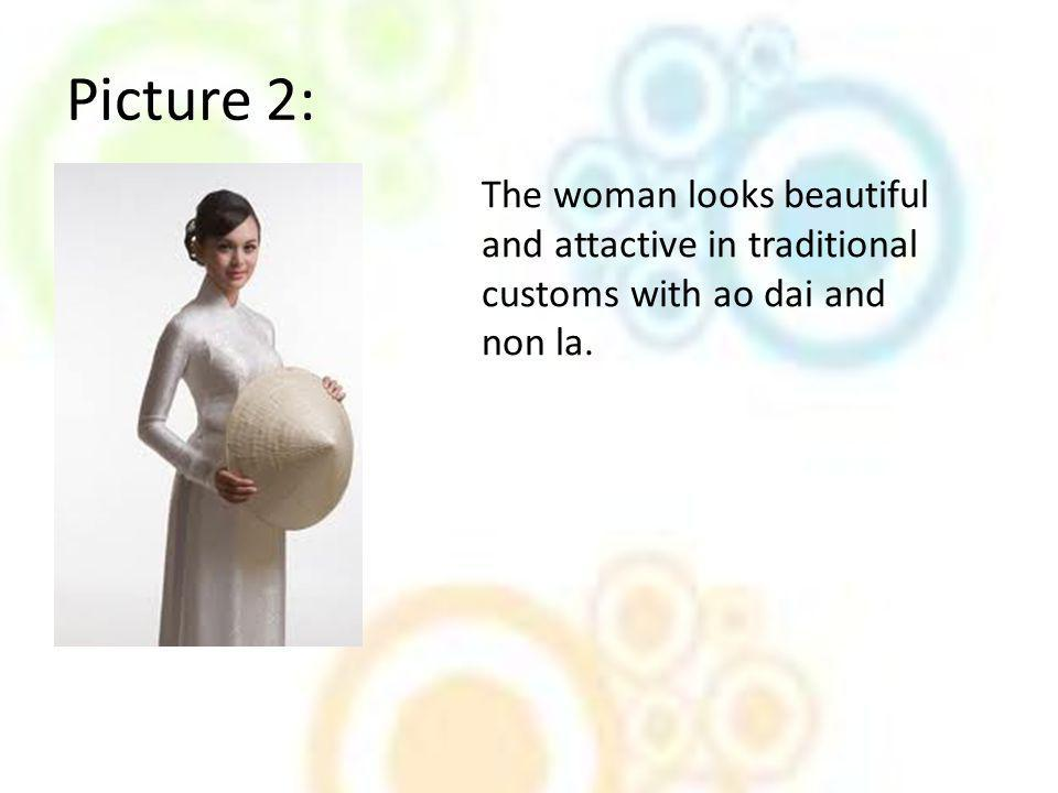 Picture 2: The woman looks beautiful and attactive in traditional customs with ao dai and non la.