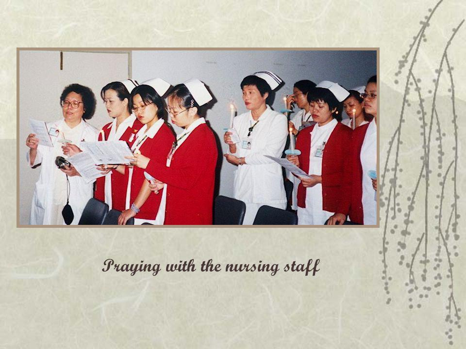 Praying with the nursing staff