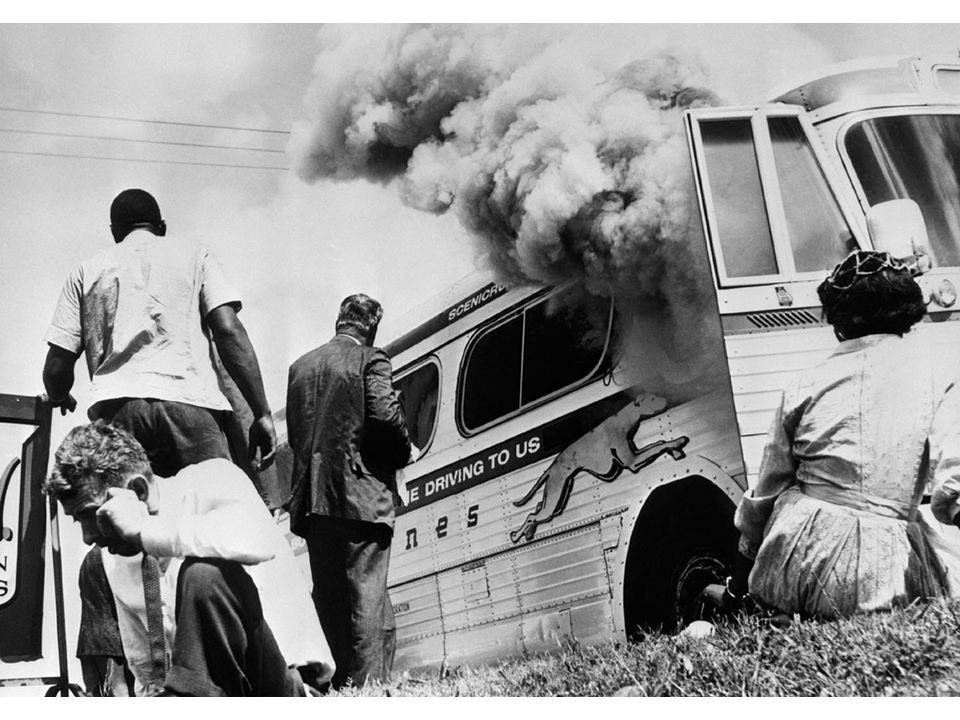 fig25_03.jpg Page 981: Freedom Riders outside their burning bus near Anniston, Alabama, in 1961.