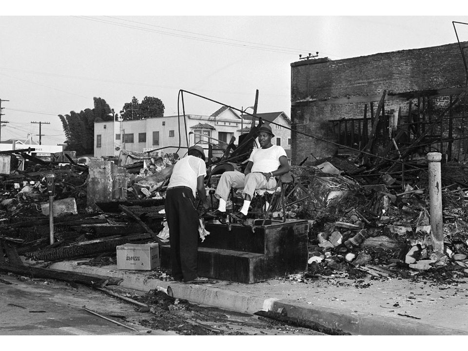 fig25_14.jpg Page 995: A semblance of normal life resumes amid the rubble of the Watts riot of August 1965.