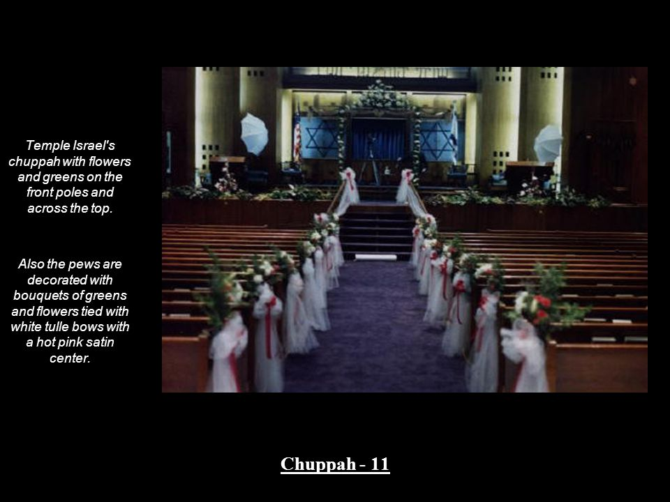 Temple Israel s chuppah with flowers and greens on the front poles and across the top.