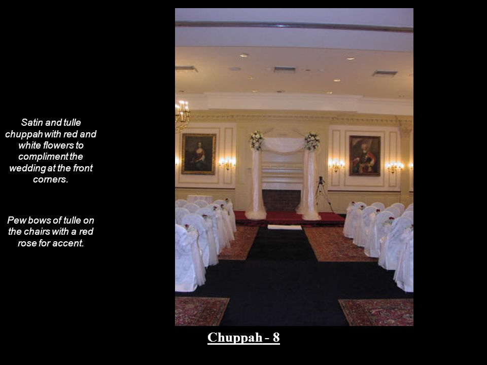 Pew bows of tulle on the chairs with a red rose for accent.