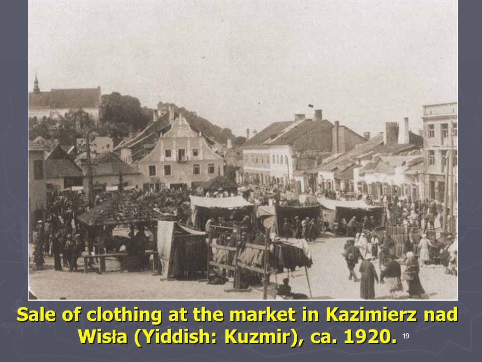 Sale of clothing at the market in Kazimierz nad Wisła (Yiddish: Kuzmir), ca. 1920.
