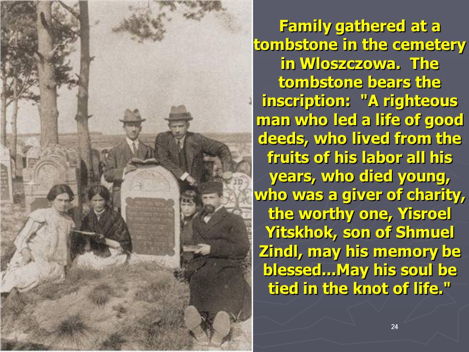 Family gathered at a tombstone in the cemetery in Wloszczowa