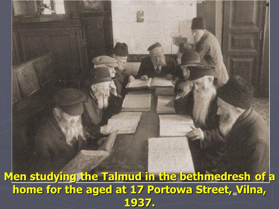 Men studying the Talmud in the bethmedresh of a home for the aged at 17 Portowa Street, Vilna, 1937.