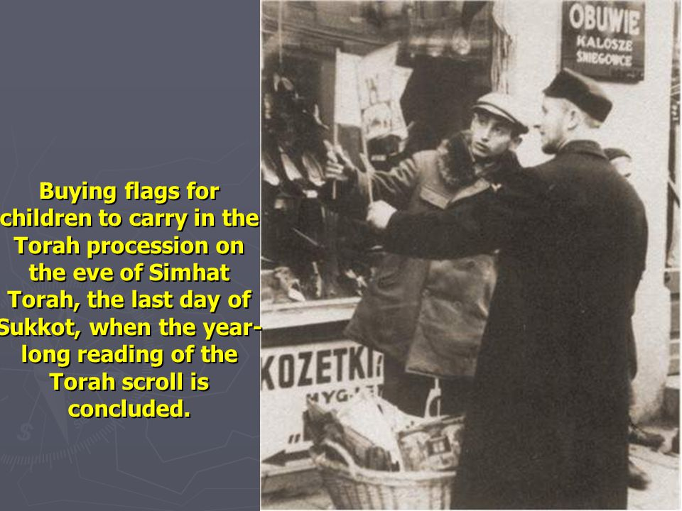 Buying flags for children to carry in the Torah procession on the eve of Simhat Torah, the last day of Sukkot, when the year-long reading of the Torah scroll is concluded.