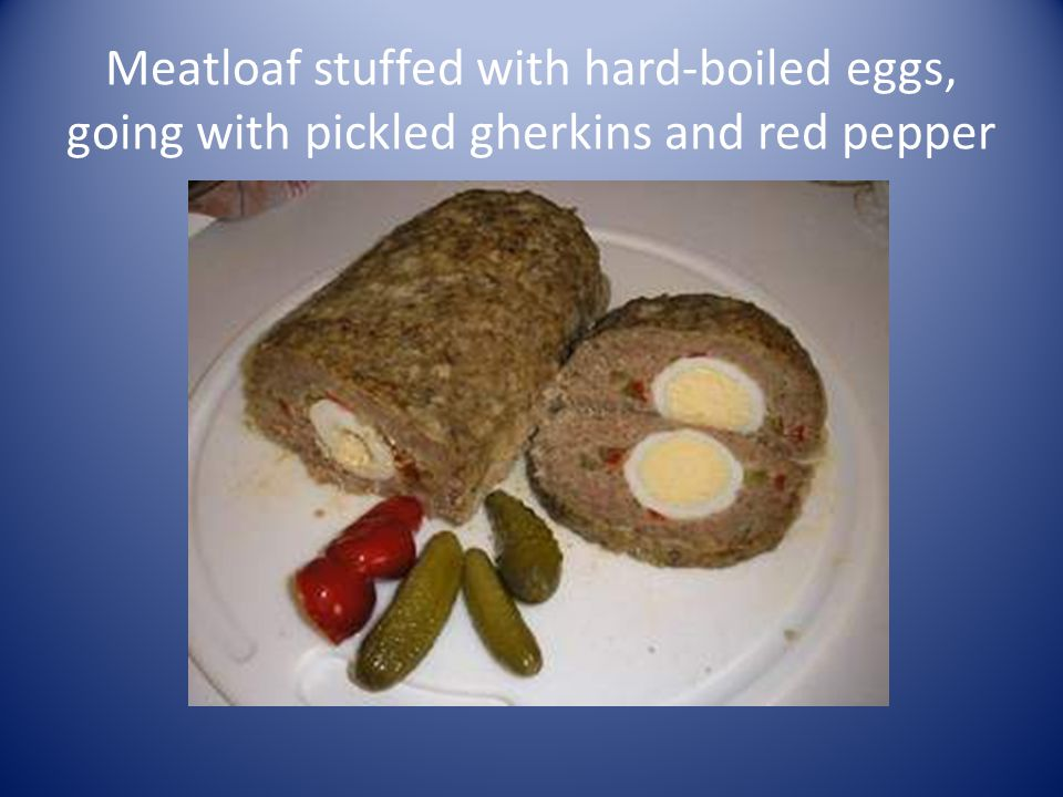 Meatloaf stuffed with hard-boiled eggs, going with pickled gherkins and red pepper