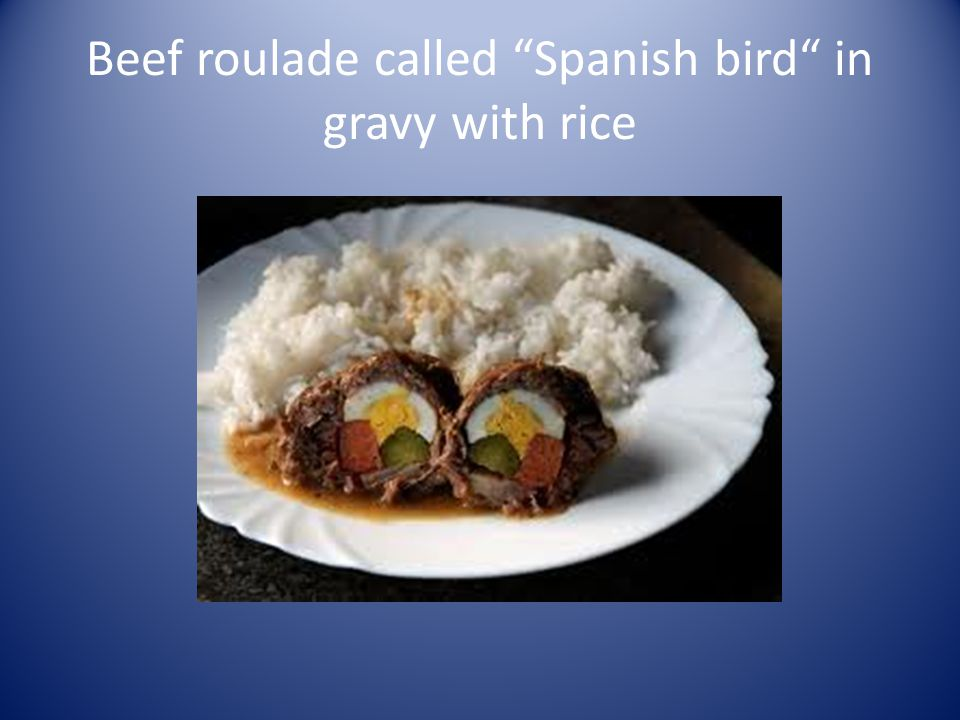 Beef roulade called Spanish bird in gravy with rice