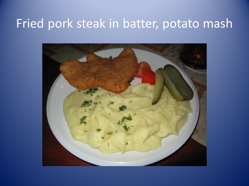 Fried pork steak in batter, potato mash
