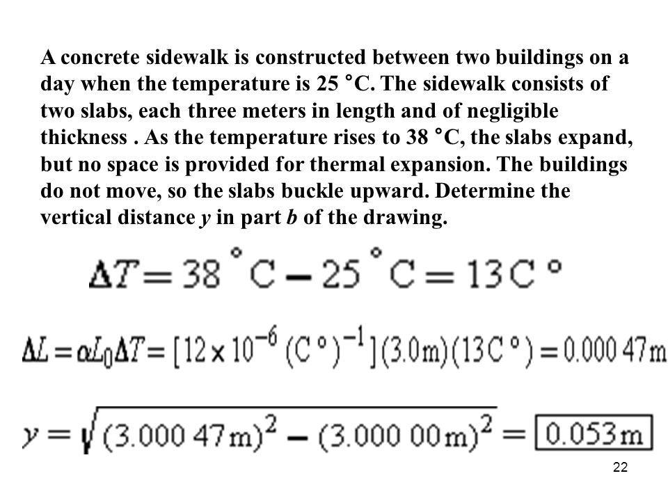 A concrete sidewalk is constructed between two buildings on a day when the temperature is 25 °C.