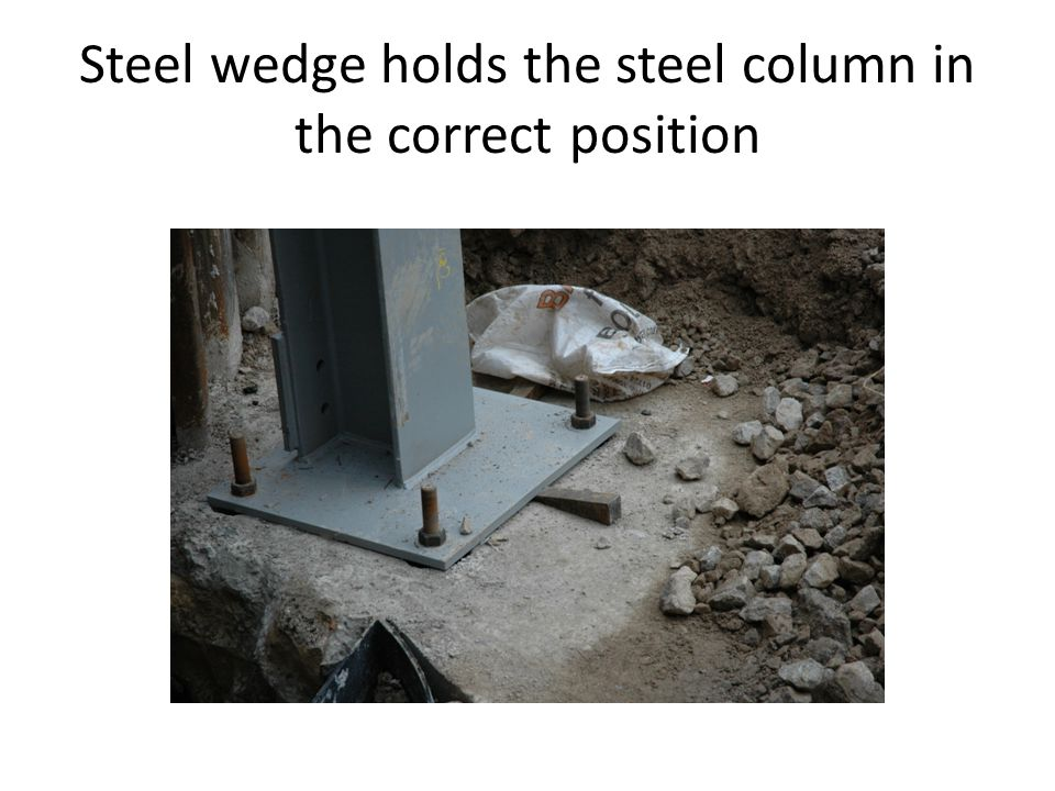 Steel wedge holds the steel column in the correct position