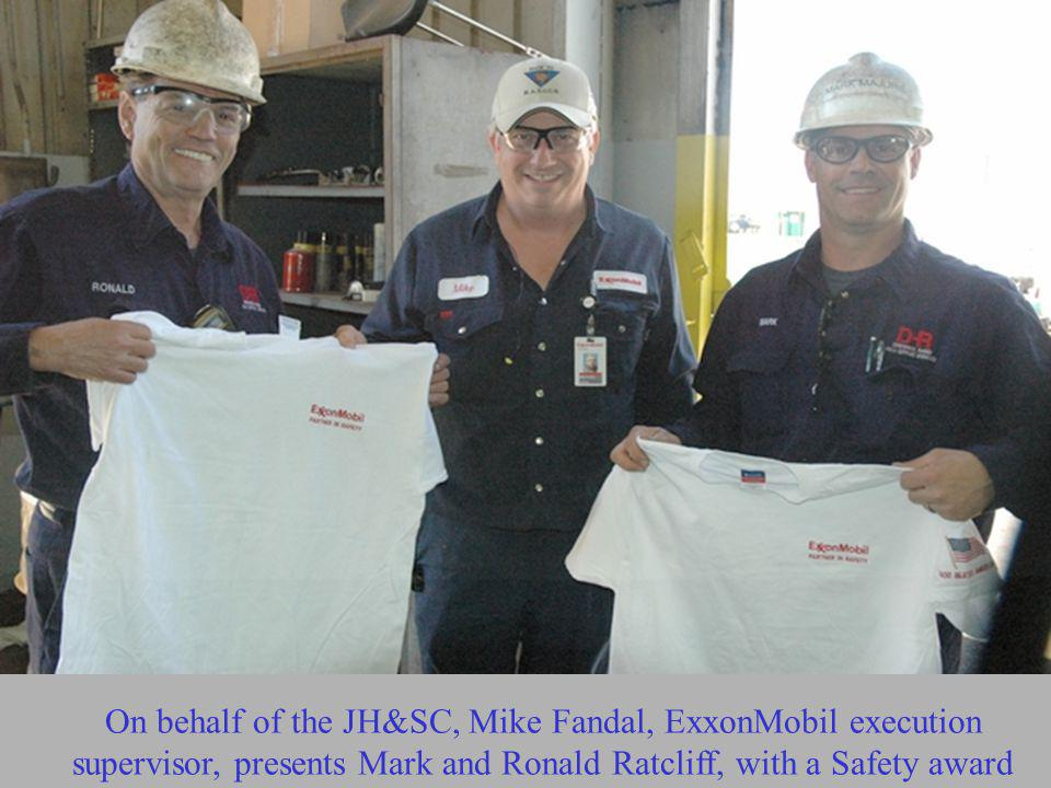 On behalf of the JH&SC, Mike Fandal, ExxonMobil execution supervisor, presents Mark and Ronald Ratcliff, with a Safety award