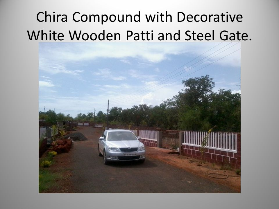 Chira Compound with Decorative White Wooden Patti and Steel Gate.