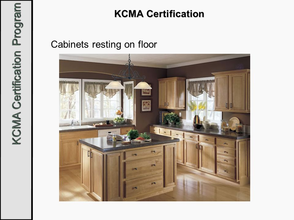 Cabinets resting on floor