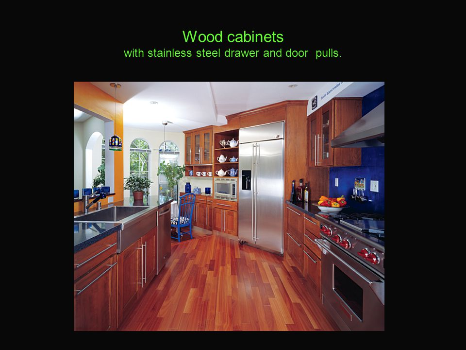 Wood cabinets with stainless steel drawer and door pulls.