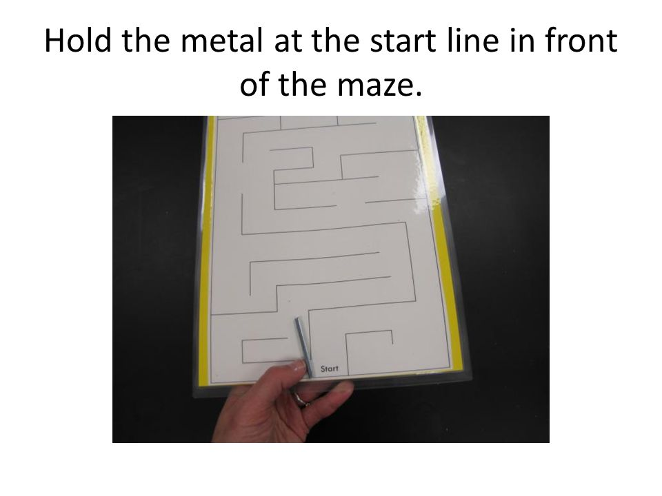 Hold the metal at the start line in front of the maze.