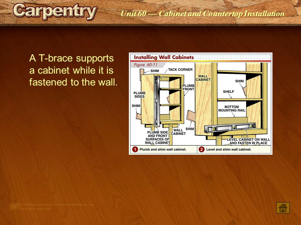 A T-brace supports a cabinet while it is fastened to the wall.