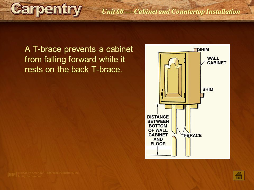 A T-brace prevents a cabinet from falling forward while it rests on the back T-brace.