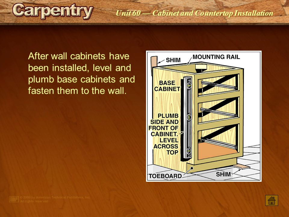 After wall cabinets have been installed, level and plumb base cabinets and fasten them to the wall.
