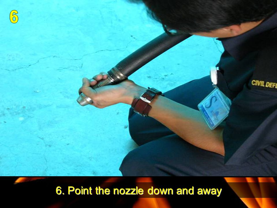 6. Point the nozzle down and away