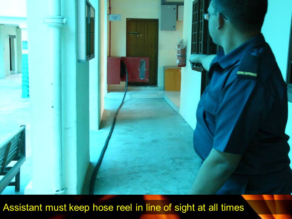 Assistant must keep hose reel in line of sight at all times