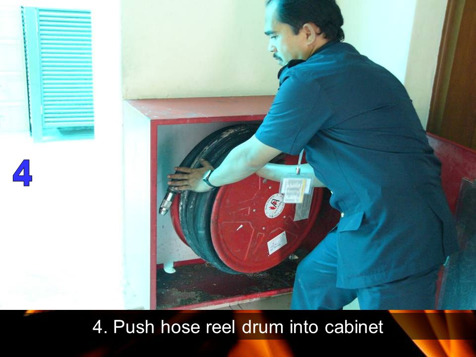 4. Push hose reel drum into cabinet