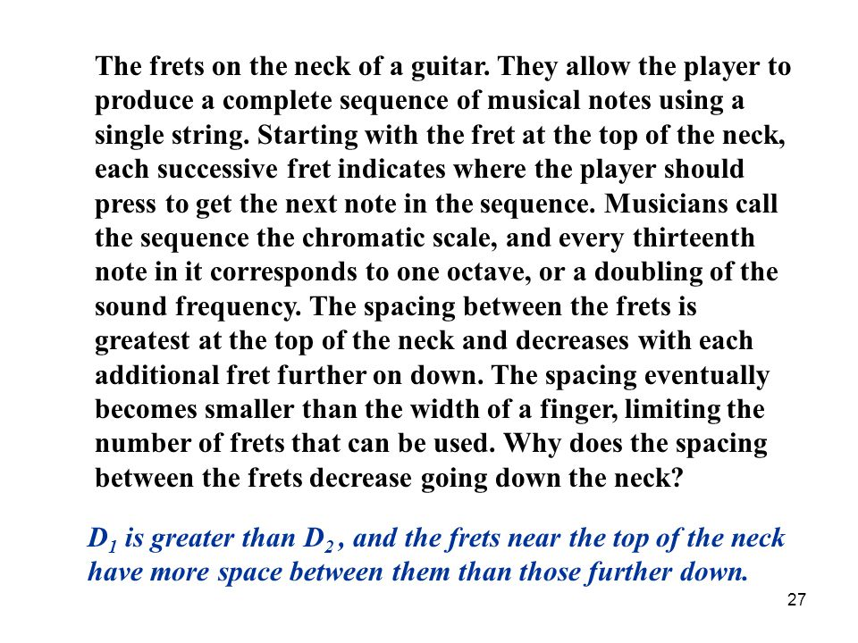 The frets on the neck of a guitar