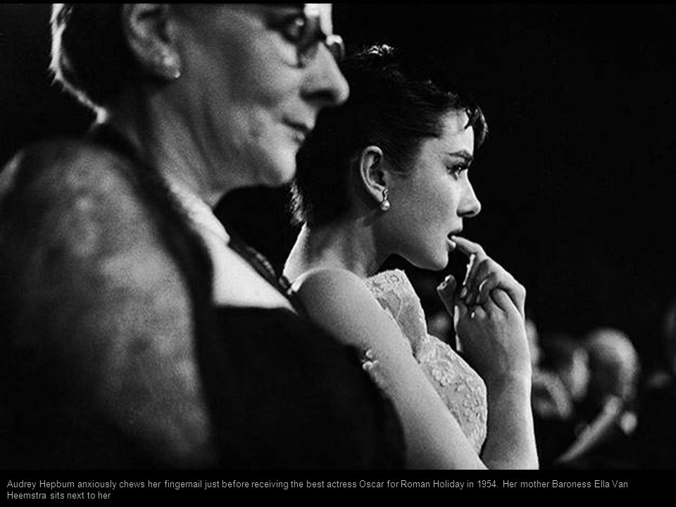 Audrey Hepburn anxiously chews her fingernail just before receiving the best actress Oscar for Roman Holiday in 1954.