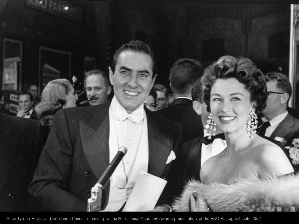 Actor Tyrone Power and wife Linda Christian, arriving for the 26th annual Academy Awards presentation, at the RKO Pantages theater.1954
