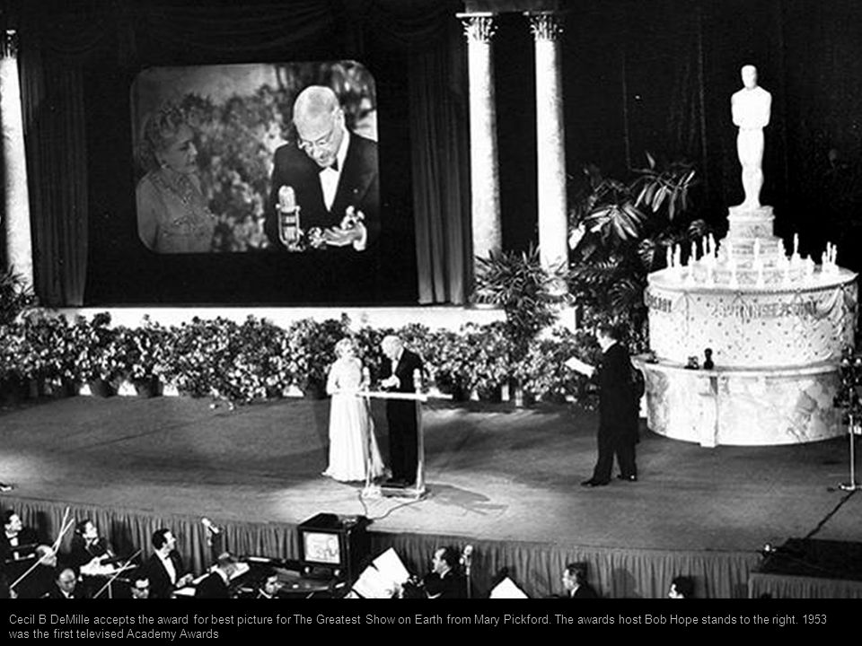 Cecil B DeMille accepts the award for best picture for The Greatest Show on Earth from Mary Pickford.