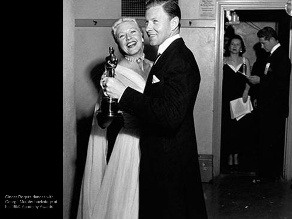 Ginger Rogers dances with George Murphy backstage at the 1950 Academy Awards