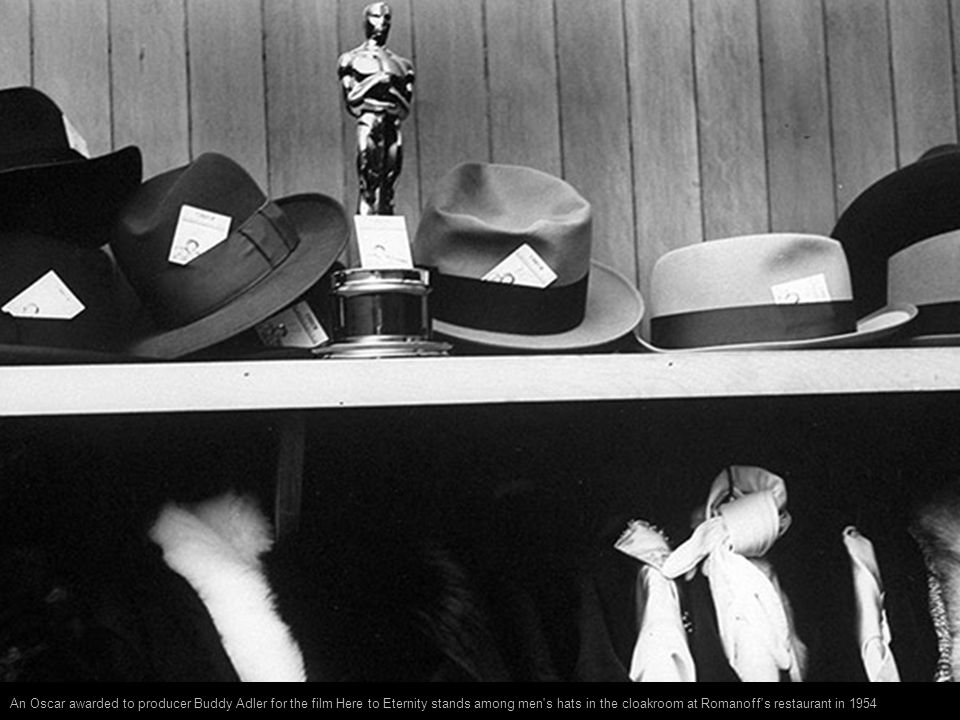 An Oscar awarded to producer Buddy Adler for the film Here to Eternity stands among men s hats in the cloakroom at Romanoff s restaurant in 1954