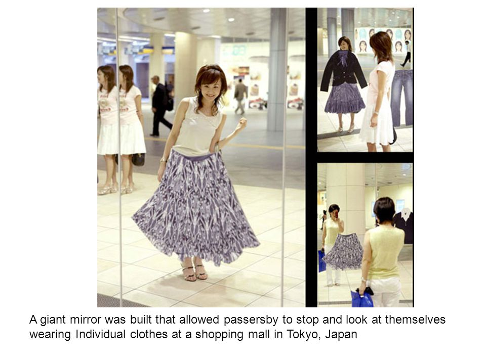 A giant mirror was built that allowed passersby to stop and look at themselves wearing Individual clothes at a shopping mall in Tokyo, Japan