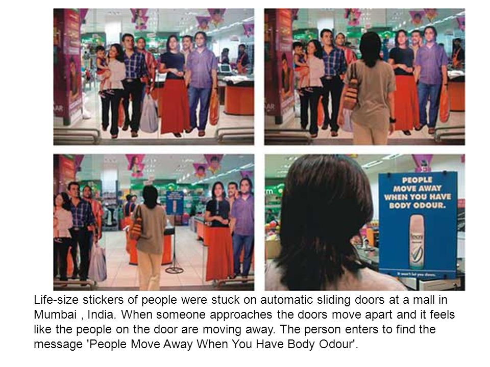 Life-size stickers of people were stuck on automatic sliding doors at a mall in Mumbai , India.